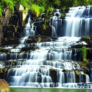 Tropical rainforest landscape with flowing Pongour waterfall in
